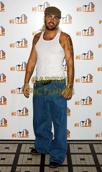 SHANE LYNCH.MTV TLR launch party.TLR UK launch date: 19 August 2003.sales@capitalpictures.com.www.capitalpictures.com.©Capital Pictures.tattoo, white singlet vest, baggy denim jeans, flat cap.full length, full-length