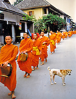 Every morning monks walk the streets receiving alms from the residents. Pentax Spotmatic film camera. 2004