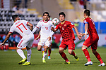 B T Dung of Vietnam (2nd R) battles for the ball with Vahid Amiri of Iran (2nd L) during the AFC Asian Cup UAE 2019 Group D match between Vietnam (VIE) and I.R. Iran (IRN) at Al Nahyan Stadium on 12 January 2019 in Abu Dhabi, United Arab Emirates. Photo by Marcio Rodrigo Machado / Power Sport Images
