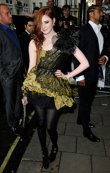 KAREN GILLAN .Glamour Women Of The Year Awards - Outside Arrivals, Berkeley Square Gardens, London, England, UK, .June 8th 2010. .full length green black lace dress one shoulder layered tights bag hand on hip.CAP/CAN.©Can Nguyen/Capital Pictures.