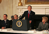 Washington, DC - February 25, 2008 -- United States President George W. Bush addresses the National Governors Association in the State Dining Room of the White House in Washington, DC on February 25, 2008. From left to right: US Secretary of Health and Human Services Mike Leavitt, Secretary of the Interior Dirk Kempthorne, President Bush, and US Secretary of Transportation Secretary Mary Peters. <br /> Credit: Dennis Brack - Pool via CNP