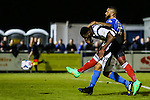 Lenell John-Lewis of Grimsby Town shoots under pressure from Jamie Turley of Eastleigh Football Club during the Vanamara Conference Play Off Semi Final First Leg match between Eastleigh and Grimsby Town at The Silverlake Stadium, Eastleigh<br /> Picture by David Horn/eXtreme aperture photography +44 7545 970036<br /> 30/04/2015