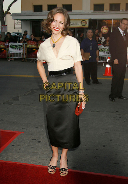 "SUSAN DOWNEY.""The Reaping"" Los Angeles Premiere held at Mann's Village Theatre, Hollywood, California, USA..March 29th, 2007.full length black satin skirt white top blouse red clutch purse hand on hip.CAP/ADM/RE.©Russ Elliot/AdMedia/Capital Pictures"