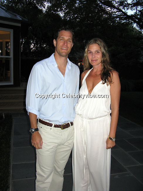 Aerin Lauder Zinterhofer, Estee Lauder granddaughter, and husband Eric Zinterhofer.MoveOpolis! Summer Gala in Bridgehampton.Chad A. Leat Residence.Bridgehampton, NY, USA.Saturday, August 09, 2008.Photo By Celebrityvibe.com.To license this image please call (212) 410 5354; or Email: celebrityvibe@gmail.com ;.website: www.celebrityvibe.com