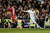 18th March 2018, Santiago Bernabeu, Madrid, Spain; La Liga football, Real Madrid versus Girona; Karim Benzema (Real Madrid) crosses the ball past Jonas Ramalho (Girona FC)