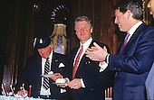 United States President Bill Clinton, center, has a piece of birthday cake at a party for U.S. House Republican Leader Robert H. Michel (Republican of Illinois), left, in the U.S. Capitol in Washington, D.C. on March 2, 1993.  U.S. Vice President Al Gore applauds at right..Credit: Jeff Markowitz / Pool via CNP