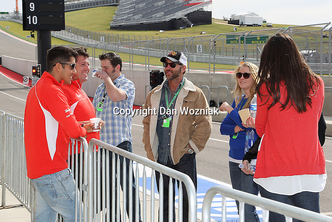 Jules Bianchi (22) driver of the Marussia F1 Team Cosworth talks with fans before the Formula 1 United States Grand Prix practice session at the Circuit of the Americas race track in Austin,Texas.