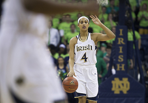March 04, 2013:  Notre Dame guard Skylar Diggins (4) calls out a play during NCAA Basketball game action between the Notre Dame Fighting Irish and the Connecticut Huskies at Purcell Pavilion at the Joyce Center in South Bend, Indiana.  Notre Dame defeated Connecticut 96-87 in triple overtime.