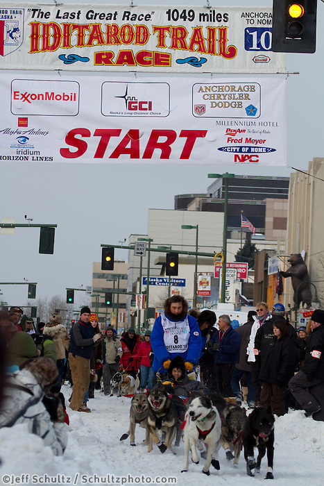 2010 Iditarod Ceremonial Start in Anchorage Alaska musher # 8 JOHN BAKER with Iditarider ERIC BROWER