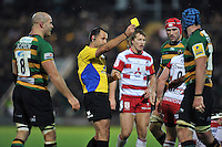 Referee Greg Garner issues a yellow card to Tom Wood of Northampton Saints. Aviva Premiership match, between Northampton Saints and Gloucester Rugby on November 27, 2015 at Franklin's Gardens in Northampton, England. Photo by: Patrick Khachfe / JMP