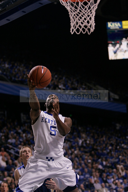 UK senior guard/forward Ramon Harris goes in for a basket during the first half of the men's basketball game against Clarion at Rupp Arena on Friday, Nov. 6, 2009. The Wildcats won 117-52 over the Golden Eagles. Photo by Adam Wolffbrandt | Staff