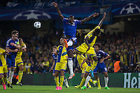 Kurt Zouma of Chelsea wins the ball in the air during the UEFA Champions League match between Chelsea and Maccabi Tel Aviv at Stamford Bridge, London, England on 16 September 2015. Photo by Andy Rowland.