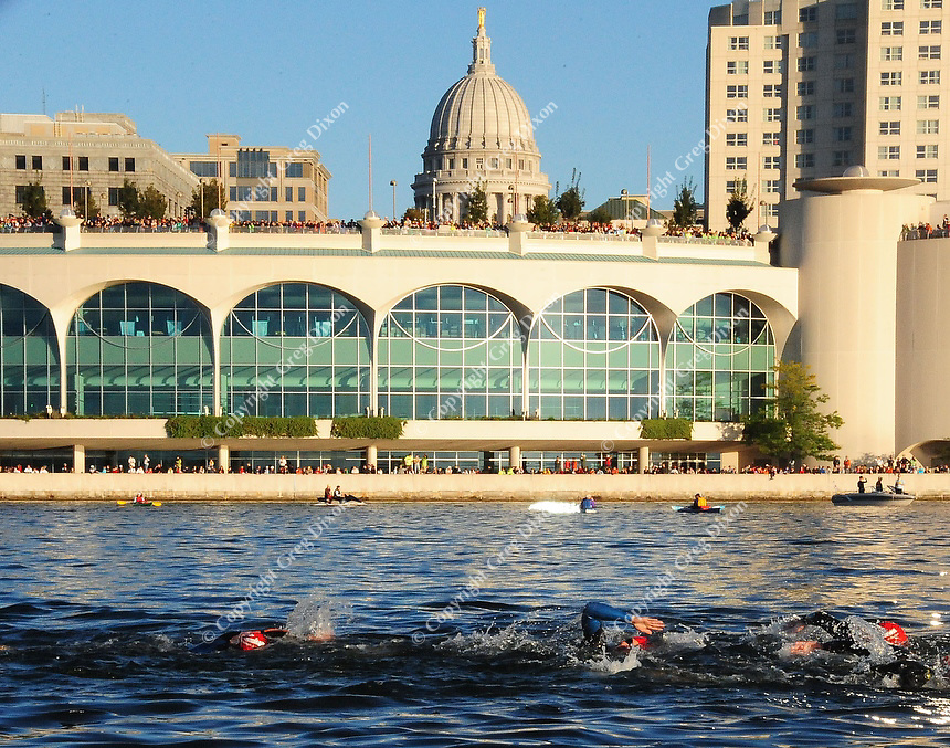 Swimmers pass in front of the State Capitol during Ironman 2010 on Sunday, 9/12/10, in Madison, Wisconsin