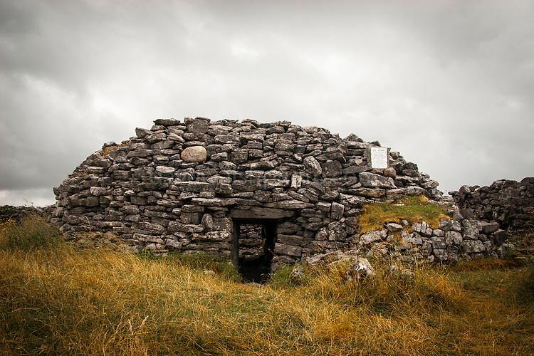 Clochan na Carraige, an early Christian stone beehive dwelling on Inishman, on the Aran Islands, Ireland.