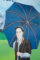 France, Aquitaine, Pyrénées-Atlantiques, Béarn, Pau: Mur peint de la Boutique:  : Au paradis du parapluie ,ou Hervé Pardo et son fils Christophe fabriquent artisanalement,le  Parapluie de berger des Pyrénées,  parapluie à manche de hêtre qui ne se retourne pas au vent grâce à ses neufs baleines//  France, Pyrenees Atlantiques, Bearn, Pau:  Au paradis du parapluie, Mr Pardo manufactures handmade Pyrenean Shepherd umbrella