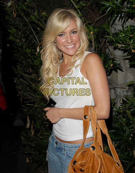 "KRISTIN CAVALLARI.Mark Burnett & AOL's Launch of ""Gold Rush"" interactive reality competition held at Les Deux in Hollywood, California, USA..September 12th, 2006.Ref: DVS.half length white tank top brown leather bag.www.capitalpictures.com.sales@capitalpictures.com.©Debbie VanStory/Capital Pictures"