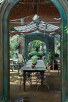 The interior of one of the greenhouses at Petersham Nurseries is used as a cafe
