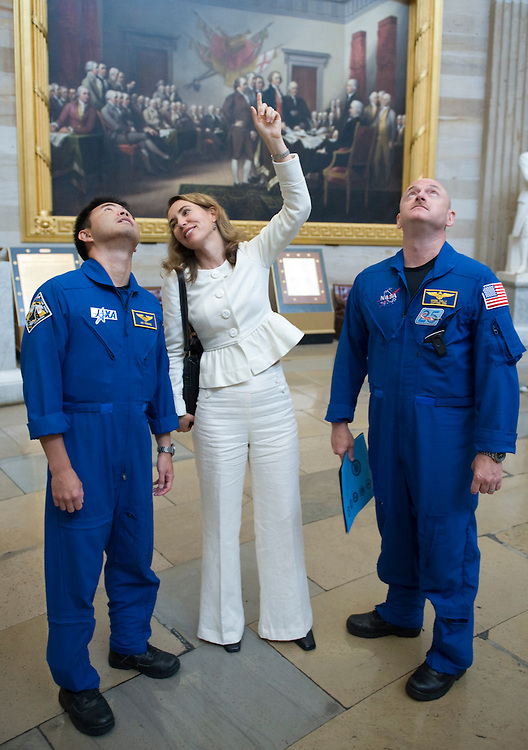 Rep. Gabrielle Giffords, D-Ariz., center, points up to the rotunda dome as she gives a tour of the Capitol to Shuttle Discovery STS-124 astronauts Mission Specialist Akihiko Hoshide, of Japan, and her husband Commander Mark Kelly on Thursday, July 17, 2008.
