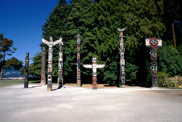 Canada: Vancouver. Totem poles in Stanley Park.  Photo #: cnvanc104..Photo copyright Lee Foster, 510/549-2202, lee@fostertravel.com, www.fostertravel.com