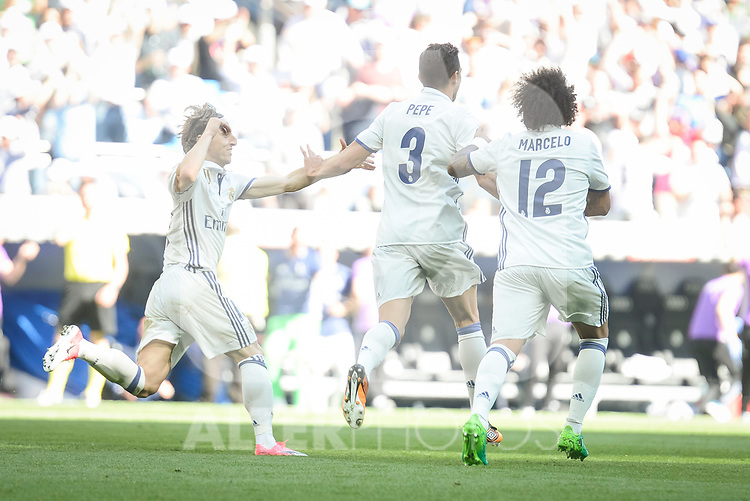 Real Madrid's Luka Modric, Pepe and Marcelo celebrating a goal during La Liga match between Real Madrid and Atletico de Madrid at Santiago Bernabeu Stadium in Madrid, April 08, 2017. Spain.<br /> (ALTERPHOTOS/BorjaB.Hojas)