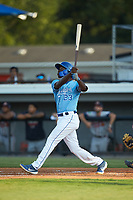 David Hollie (23) of the Burlington Royals follows through on his swing against the Danville Braves at Burlington Athletic Stadium on August 9, 2019 in Burlington, North Carolina. The Royals defeated the Braves 6-0. (Brian Westerholt/Four Seam Images)