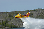 Water bomber drops load of water.