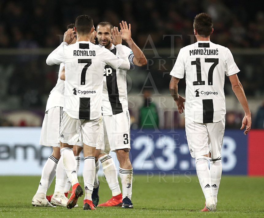 Calcio, Serie A: Fiorentina - Juventus, stadio Artemio Franchi Firenze 1 dicembre 2018.<br /> Juventus' captain Giorgio Chiellini (c) celebrates after scoring with his teammate Cristiano Ronaldo (l) during the Italian Serie A football match between Fiorentina and Juventus at Florence's Artemio Franchi stadium, December 1, 2018.<br /> UPDATE IMAGES PRESS/Isabella Bonotto