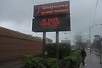 """A sign at Walgreens advertises """"swine flu masks"""" in the Hyde Park neighborhood of Chicago, Illinois on April 30, 2009."""