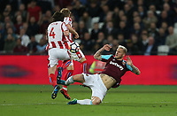 West Ham United's Marko Arnautovic challenges Stoke City's Joe Allen<br /> <br /> Photographer Rob Newell/CameraSport<br /> <br /> The Premier League - West Ham United v Stoke City - Monday 16th April 2018 - London Stadium - London<br /> <br /> World Copyright &copy; 2018 CameraSport. All rights reserved. 43 Linden Ave. Countesthorpe. Leicester. England. LE8 5PG - Tel: +44 (0) 116 277 4147 - admin@camerasport.com - www.camerasport.com
