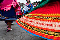"Young girls, wearing colorful skirts, dance in a procession during the Inti Raymi fiesta in Pichincha province, Ecuador, 27 June 2010. Inti Raymi, ""Festival of the Sun"" in Quechua language, is an ancient spiritual ceremony held in the Indian regions of the Andes, mainly in Ecuador and Peru. The lively celebration, set by the winter solstice, goes on for various days. The highland Indians, wearing beautiful costumes, dance, drink and sing with no rest. Colorful processions in honor of the God Inti (Sun) pass through the mountain villages giving thanks for the harvest and expressing their deep relation to the Mother Earth (Pachamama)."