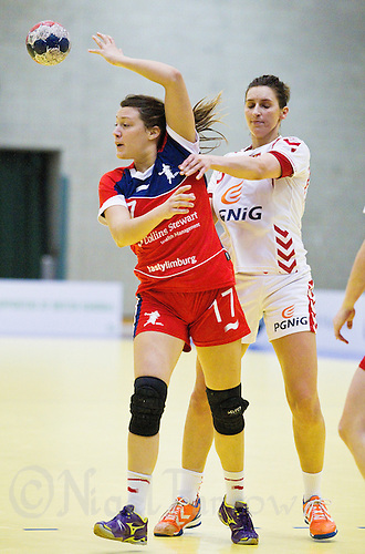 22 MAR 2012 - LOUGHBOROUGH, GBR - Great Britain's Ewa Palies (GBR) (left, in red and blue) passes during the women's 2012 European Handball Championships qualification match against Poland at Loughborough University in Loughborough, Great Britain .(PHOTO (C) 2012 NIGEL FARROW)