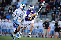 Baltimore, MD - April 5: Midfielder Mike Woods # 25 of the Albany Great Dane's defends Midfielder John Greeley #9 of the John Hopkins Blue Jays player during the Albany v Johns Hopkins mens lacrosse game at  Homewood Field on April 5, 2012 in Baltimore, MD. (Ryan Lasek/Eclipse Sportwire)