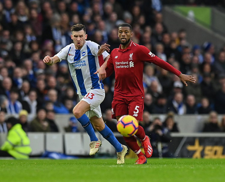Brighton & Hove Albion's Pascal Gross (left) vies for possession with Liverpool's Georginio Wijnaldum (right) <br /> <br /> Photographer David Horton/CameraSport<br /> <br /> The Premier League - Brighton and Hove Albion v Liverpool - Saturday 12th January 2019 - The Amex Stadium - Brighton<br /> <br /> World Copyright © 2018 CameraSport. All rights reserved. 43 Linden Ave. Countesthorpe. Leicester. England. LE8 5PG - Tel: +44 (0) 116 277 4147 - admin@camerasport.com - www.camerasport.com