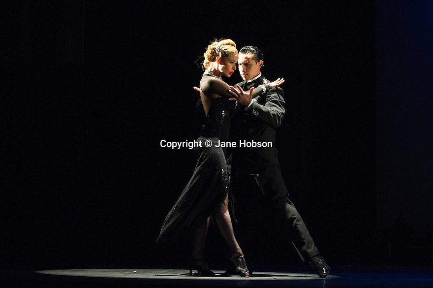 London, UK. 30.01.2013. Tango Fire Company presents FLAMES OF DESIRE at the Peacock Theatre. Picture shows: Marcos Esteban Roberts and Louise Junqueira Malucelli. Photo credit: Jane Hobson.