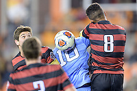 Houston, TX - Friday December 9, 2016: Brian Nana-Sinkam (8) of the Stanford Cardinal and Zach Wright (10) of the North Carolina Tar Heels battle for the ball with a header at the NCAA Men's Soccer Semifinals at BBVA Compass Stadium in Houston Texas.