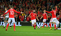 Joe Ledley of Wales (C) passes the ball during the FIFA World Cup Qualifier Group D match between Wales and Republic of Ireland at The Cardiff City Stadium, Wales, UK. Monday 09 October 2017