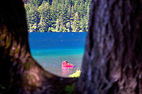 Girl palying in Lake Crescent. Olympic National Park. Washington