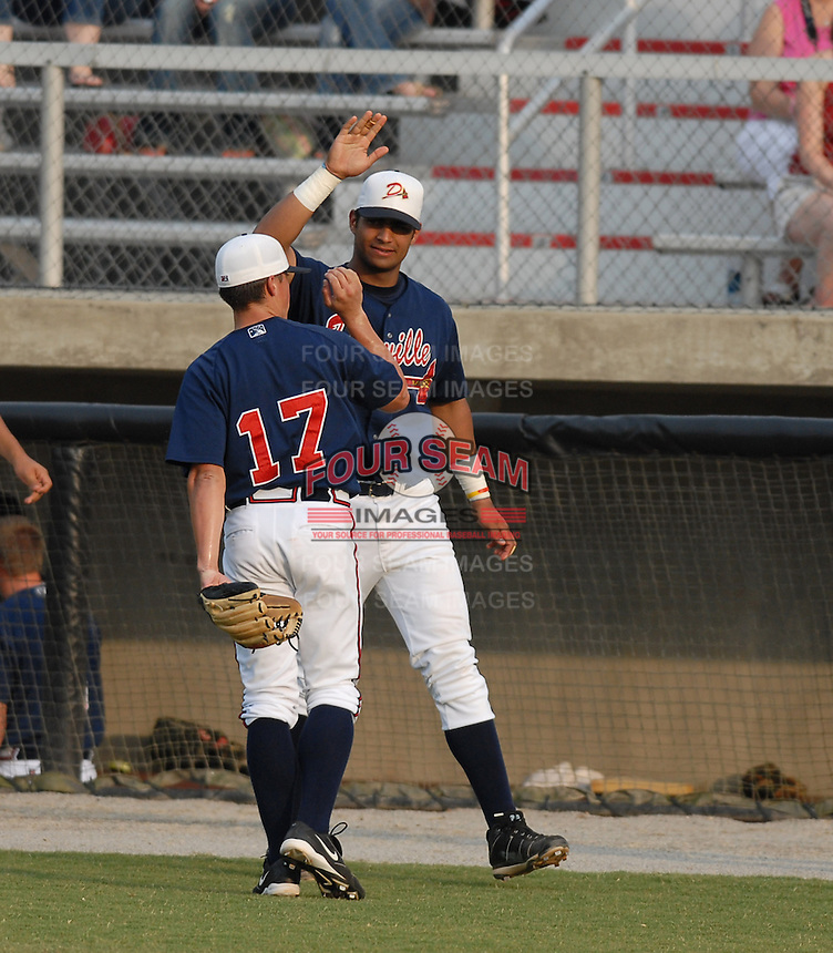 14 July 2006: Pitcher Kris Medlen (17) of the Danville Braves is congratulated after finishing an inning in a game at Dan Daniel Park in Danville, Va. (Tom Priddy/Four Seam Images)