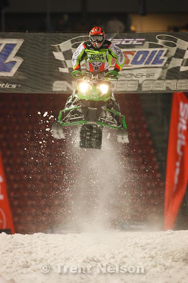 Trent Nelson  |  The Salt Lake Tribune.Cody Tomsen flies over the finish line, taking first place in the Semi Pro Open race at the Western Nationals of the AMSOIL Championship Snocross Series at Rio Tinto Stadium in Sandy, Saturday, January 9, 2010.