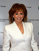 Reba McEntire arrives for the formal Artist's Dinner honoring the recipients of the 41st Annual Kennedy Center Honors hosted by United States Deputy Secretary of State John J. Sullivan at the US Department of State in Washington, D.C. on Saturday, December 1, 2018. The 2018 honorees are: singer and actress Cher; composer and pianist Philip Glass; Country music entertainer Reba McEntire; and jazz saxophonist and composer Wayne Shorter. This year, the co-creators of Hamilton­ writer and actor Lin-Manuel Miranda, director Thomas Kail, choreographer Andy Blankenbuehler, and music director Alex Lacamoire will receive a unique Kennedy Center Honors as trailblazing creators of a transformative work that defies category.<br /> Credit: Ron Sachs / Pool via CNP
