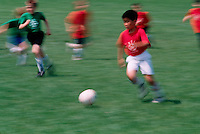 Yong boys playing soccer.