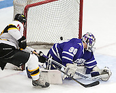 Seric Kapp (WIT - 15) scored the only goal of the game in the first. - The Wentworth Institute of Technology Leopards defeated the visiting Curry College Colonels 1-0 on Saturday, November 23, 2013, at Walter Brown Arena in Boston, Massachusetts.