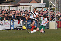 Nathan Arnold of Grimsby Town is challenged by James Crane of Bognor Regis Town during the FA Trophy Semi Final first leg match between Bognor Regis and Grimsby Town at Nyewood Lane, Bognor Regis, England on 12 March 2016. Photo by Paul Paxford/PRiME Media Images.