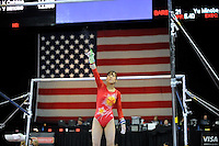 02/20/09 - Photo by John Cheng for USA Gymnastics.  Japanese gymnast Keiko Mukumoto performs on uneven bars in a meet against US before the Tyson American Cup at Sears Centre Arena in Chicago.