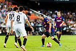 Lionel Messi of FC Barcelona (R) in action during their La Liga 2018-19 match between Valencia CF and FC Barcelona at Estadio de Mestalla on October 07 2018 in Valencia, Spain. Photo by Maria Jose Segovia Carmona / Power Sport Images