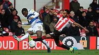 Bright Osayi-Samuel of QPR crosses the ball as Brentford's Rico Henry tries to intercept during Brentford vs Queens Park Rangers, Sky Bet EFL Championship Football at Griffin Park on 11th January 2020