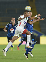 BOGOTA - COLOMBIA -07 -02-2015: Fernando Uribe (Der.) jugador de Millonarios salta por el balón con Carlos Henao (Izq.) jugador de Patriotas FC, durante partido entre Millonarios y Patriotas FC por la fecha 2 de la Liga Aguila I-2015, jugado en el estadio Nemesio Camacho El Campin de la ciudad de Bogota. / Fernando Uribe (R) player of Millonarios jumps for the ball with Carlos Henao (L) player of Patriotas FC, during a match between Millonarios and Patriotas FC for the  date 1 of the Liga Aguila I-2015 at the Nemesio Camacho El Campin Stadium in Bogota city, Photo: VizzorImage / Gabriel Aponte / Staff.