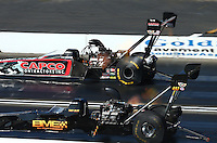 Feb 8, 2015; Pomona, CA, USA; NHRA top fuel driver Steve Torrence (far lane) races alongside Troy Buff during the Winternationals at Auto Club Raceway at Pomona. Mandatory Credit: Mark J. Rebilas-