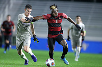 CARY, NC - DECEMBER 13: Ousseni Bouda #11 of Stanford University holds off a challenge by Dylan Nealis #12 of Georgetown University during a game between Stanford and Georgetown at Sahlen's Stadium at WakeMed Soccer Park on December 13, 2019 in Cary, North Carolina.