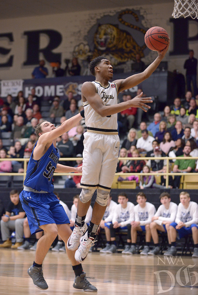 NWA Democrat-Gazette/BEN GOFF @NWABENGOFF<br /> Malik Monk of Bentonville attempts a layup as Harrison Heffley of Rogers guards on Saturday Jan. 23, 2016 during the game in Bentonville's Tiger Arena.
